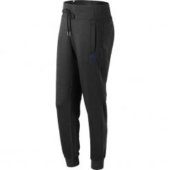 New Balance WP73535BK. Czarne spodnie dresowe damskie marki KIPSTA, l, z bawełny, na fitness i siłownię. W wyprzedaży za 169,99 zł.