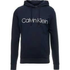 Calvin Klein KAMS HOODY Bluza z kapturem blue. Pomarańczowe bluzy męskie rozpinane marki Calvin Klein, l, z bawełny, z okrągłym kołnierzem. Za 449,00 zł.