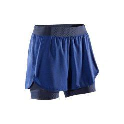Spodenki fitness kardio damskie 900. Niebieskie spodenki sportowe męskie marki DOMYOS, z elastanu. W wyprzedaży za 44,99 zł.