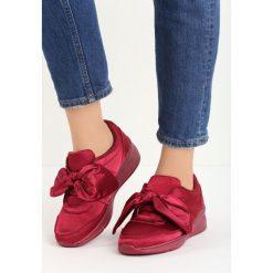Czerwone Buty Sportowe We Found Love. Czerwone buty sportowe damskie marki KALENJI, z gumy. Za 89,99 zł.