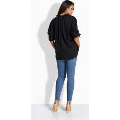 Luźna casualowa koszula z kokardką z tyłu czarny KIMBERLY. Czarne koszule wiązane damskie Lemoniade, z kokardą. Za 49,00 zł.