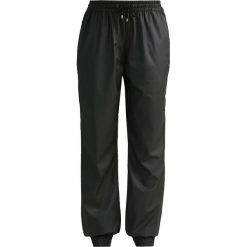 Spodnie dresowe damskie: Rains Spodnie treningowe black