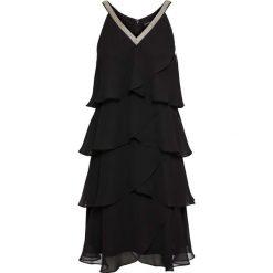 Sukienka z falbanami i aplikacją bonprix czarny. Czarne sukienki na komunię marki bonprix, z aplikacjami. Za 109,99 zł.