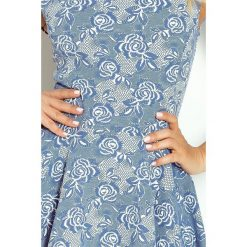 Raven Ekskluzywna sukienka motylek - granatowa kwiatowy wzór. Niebieskie sukienki na komunię numoco. Za 169,99 zł.