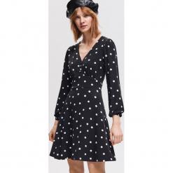 Sukienka ze wzorem - Wielobarwn. Czarne sukienki marki Reserved, l. Za 79,99 zł.