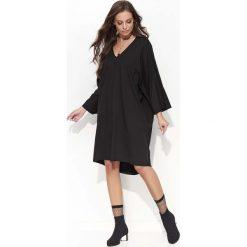 Czarna Oversizowa Sukienka z Szerokim Rękawem Typu Kimono. Czarne sukienki balowe marki Molly.pl, do pracy, l, z bawełny, oversize. Za 103,90 zł.