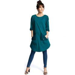 AUDREY Sukienka tunika z zaokrąglonym dołem i wykładanymi kieszeniami - zielona. Zielone sukienki marki Mohito, l, z wykładanym kołnierzem. Za 169,90 zł.