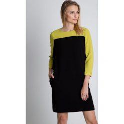 Zielono-czarna sukienka z kieszeniami BIALCON. Czarne sukienki koktajlowe marki BIALCON, na co dzień, z tkaniny. W wyprzedaży za 230,00 zł.