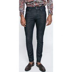 Diesel - Jeansy. Niebieskie jeansy męskie z dziurami Diesel. W wyprzedaży za 399,90 zł.