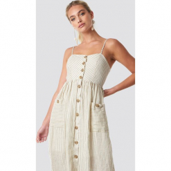 MANGO Sukienka Emilia - Beige. Szare sukienki z falbanami marki Mango, na co dzień, l, z tkaniny, casualowe, z dekoltem halter, na ramiączkach, midi, rozkloszowane. Za 202,95 zł.