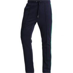 Calvin Klein Jeans SIDE STRIPE TRACK PANTS Spodnie treningowe dark blue. Niebieskie jeansy męskie Calvin Klein Jeans, z bawełny. Za 549,00 zł.