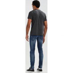 Calvin Klein JALOT REFINED  Tshirt z nadrukiem grey. Pomarańczowe t-shirty męskie z nadrukiem marki Calvin Klein, l, z bawełny, z okrągłym kołnierzem. Za 229,00 zł.