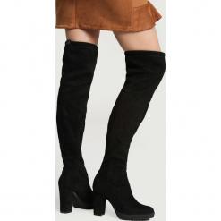 Czarne Zamszowe Kozaki More Strength. Czarne buty zimowe damskie vices, z materiału, z okrągłym noskiem, na wysokim obcasie, na obcasie. Za 94,99 zł.