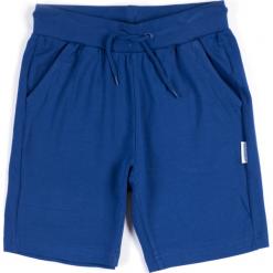 Spodnie. Niebieskie chinosy chłopięce GYMNASTIC, z bawełny. Za 29,90 zł.