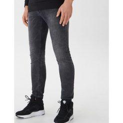 Jeansy slim fit - Szary. Szare jeansy męskie relaxed fit marki House. Za 99,99 zł.