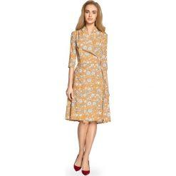 ALMA Zwiewna sukienka z wiązaniem - miodowa. Pomarańczowe sukienki hiszpanki Stylove, z nadrukiem, midi. Za 199,00 zł.