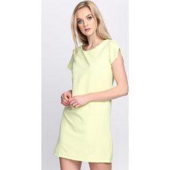 Jasnozielona Sukienka The Bridge. Zielone sukienki hiszpanki Born2be, na lato, l, oversize. Za 29,99 zł.