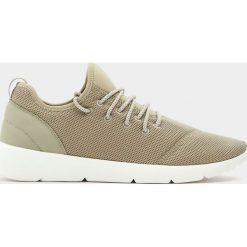 Buty męskie: Techniczne buty sportowe w piaskowym kolorze