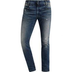 GStar DSTAQ 5PKT SLIM Jeansy Slim Fit medium aged antic destroy. Niebieskie jeansy męskie relaxed fit G-Star. Za 659,00 zł.