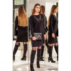 Czarna sukienka z przeszyciem. Czarne sukienki z falbanami marki Pakamera, na co dzień, midi. Za 189,00 zł.