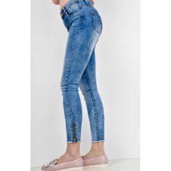 Rurki damskie: Spodnie jeansowe rurki z zamkami na nogawkach