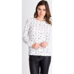Bluzki asymetryczne: Biała bluzka w kropki QUIOSQUE