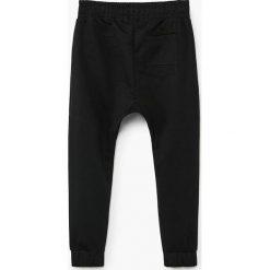 Mango Kids - Spodnie dziecięce Roger 110-164 cm. Czarne spodnie chłopięce marki Mango Kids, z bawełny. Za 69,90 zł.