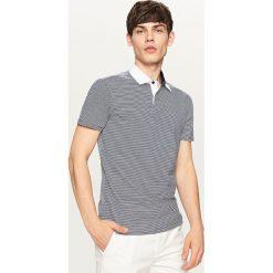 Koszulka polo w paski - Granatowy. Niebieskie koszulki polo Reserved, m, w paski. W wyprzedaży za 29,99 zł.