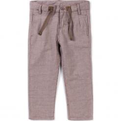 Spodnie. Brązowe chinosy chłopięce STEGOSAURUS, z bawełny. Za 39,90 zł.