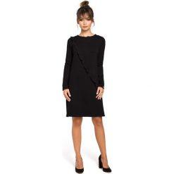 BRODY Sukienka z falbanką z przodu - czarna. Czarne sukienki hiszpanki BE, l, z falbankami, z długim rękawem, oversize. Za 154,90 zł.