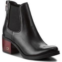 Botki CARINII - B4667/C E50-000-POL-861. Czarne buty zimowe damskie Carinii, ze skóry, na obcasie. Za 419,00 zł.