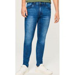 Jeansy skinny - Granatowy. Niebieskie jeansy męskie skinny marki Reserved. W wyprzedaży za 69,99 zł.