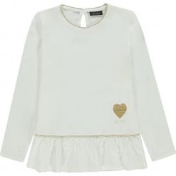 Bluzka w kolorze białym. Białe bluzki dziewczęce marki Marc O'Polo Junior, z nadrukiem, z okrągłym kołnierzem, z długim rękawem. W wyprzedaży za 105,95 zł.