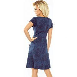 Isabel Sukienka TRAPEZOWA z kieszonkami - JEANS CIEMNY GRANAT. Różowe sukienki na komunię marki numoco, l, z długim rękawem, maxi, oversize. Za 149,99 zł.