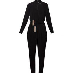 MICHAEL Michael Kors SOLID TIE JMPSUIT Kombinezon black. Czarne kombinezony damskie marki MICHAEL Michael Kors, xs, z elastanu. W wyprzedaży za 557,55 zł.