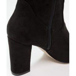 Madden Girl FELIZE Kozaki na obcasie black. Czarne buty zimowe damskie Madden Girl, z materiału, na obcasie. W wyprzedaży za 230,45 zł.