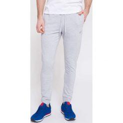 Spodnie dresowe męskie: Spodnie dresowe męskie SPMD300 – szary melanż