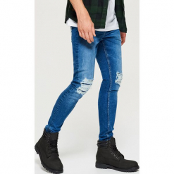 Jeansy SKINNY - Granatowy. Niebieskie jeansy męskie regular Cropp. Za 119,99 zł.