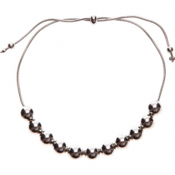 Bransoletka ze srebrnymi kulkami QUIOSQUE. Szare bransoletki damskie sznurkowe marki QUIOSQUE, srebrne. W wyprzedaży za 14,99 zł.