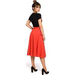 CAMILLE Rozkloszowana spódnica z kieszeniami - czerwona. Czerwone spódnice wieczorowe BE, l, z dzianiny, midi, oversize. Za 119,99 zł.