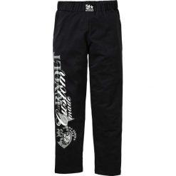 Spodnie dresowe bonprix czarny. Czarne spodnie dresowe męskie marki bonprix, z aplikacjami, z dresówki. Za 79,99 zł.