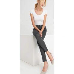 Spodnie skinny. Niebieskie rurki damskie marki Orsay, w jednolite wzory, z bawełny. Za 79,99 zł.