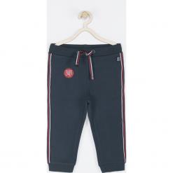 Spodnie. Niebieskie chinosy chłopięce SUPER COOL, z bawełny. Za 49,90 zł.
