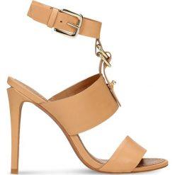 Sandały PURU. Białe sandały damskie marki Coqui, na wysokim obcasie. Za 249,90 zł.