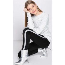 Czarno-Białe Spodnie Dresowe Patience. Białe spodnie dresowe damskie Born2be, l, z dresówki. Za 39,99 zł.