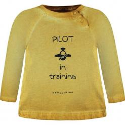 Koszulka w kolorze żółtym. Żółte t-shirty chłopięce z długim rękawem bellybutton, z nadrukiem, z bawełny. W wyprzedaży za 37,95 zł.