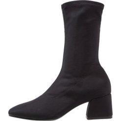 Vagabond ALICE Kozaki black. Czarne buty zimowe damskie marki Vagabond, z materiału. Za 499,00 zł.