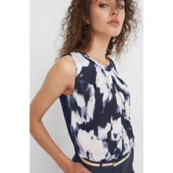 Koszula bimaterial ze wzorem. Niebieskie koszule wiązane damskie Orsay, xs, z dzianiny, z dekoltem na plecach. Za 69,99 zł.