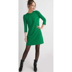 Sukienki hiszpanki: Trapezowa sukienka z bufkami