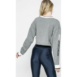 Nike Sportswear - Bluza dwustronna. Różowe bluzy z nadrukiem damskie marki Nike Sportswear, l, z nylonu, z okrągłym kołnierzem. W wyprzedaży za 219,90 zł.